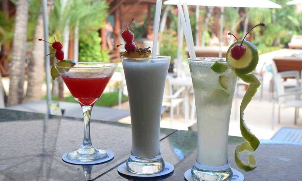 Holiday hacks when drinking abroad - Shows 3 exotic cocktails