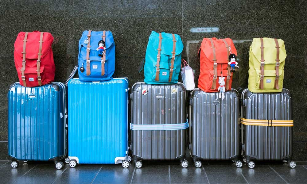 Tips for packing your suitcase - Holiday hacks and tips. Depicts luggage at an airport
