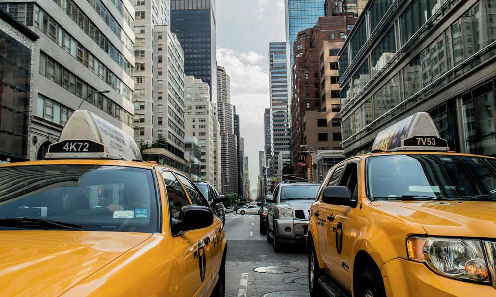 Holiday tips for ordering a taxi - depicts yellow New York City taxis