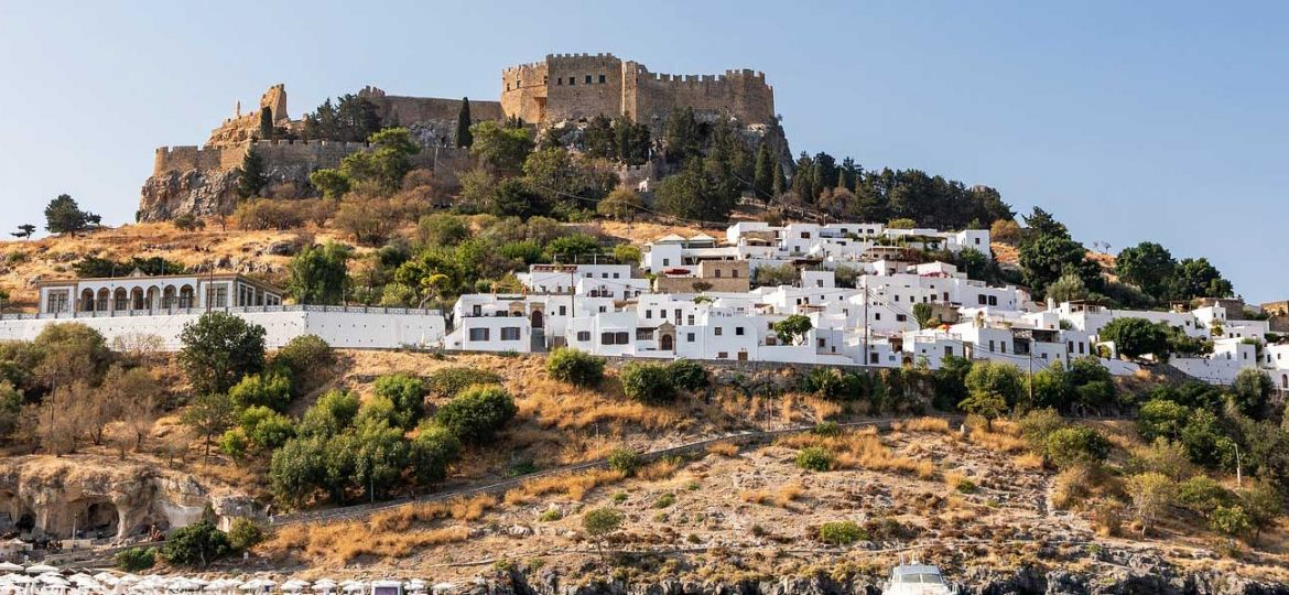 Lindos travel guide - shows Lindos town Acropolis and white buildings