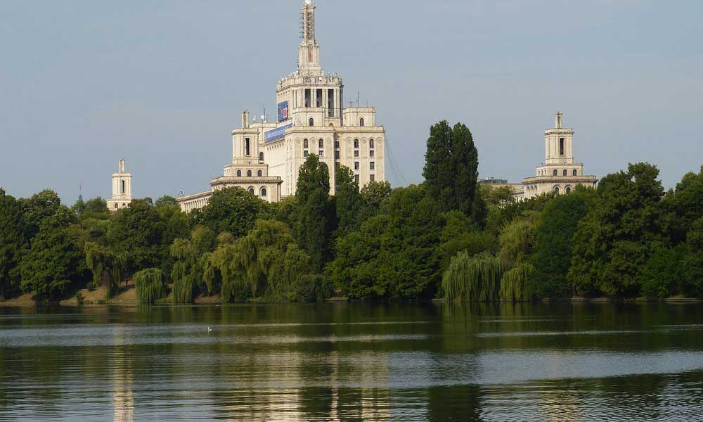 Cheap August city break holidays - Shows Bucharest river and buildings