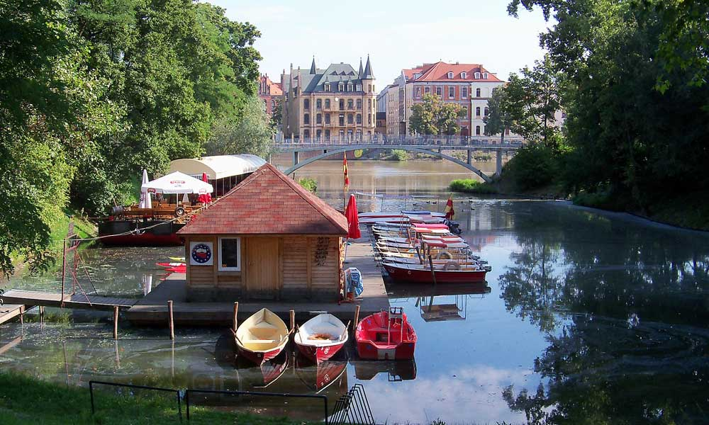 August city break ideas - Shows Wroclaw river and boats, Poland
