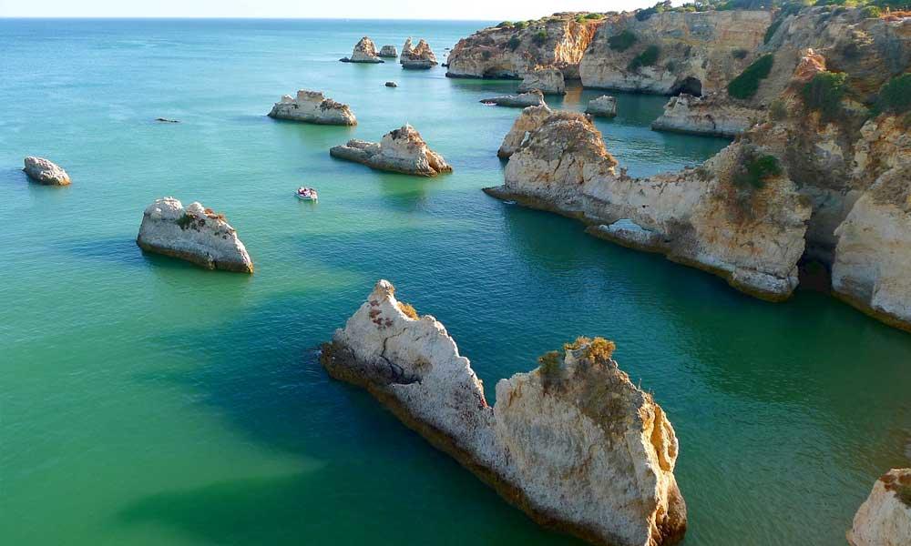Shows Algarve coastline rock formations