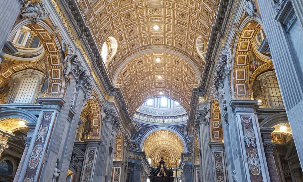 Shows the interior of St Peter's Basilica, Rome.
