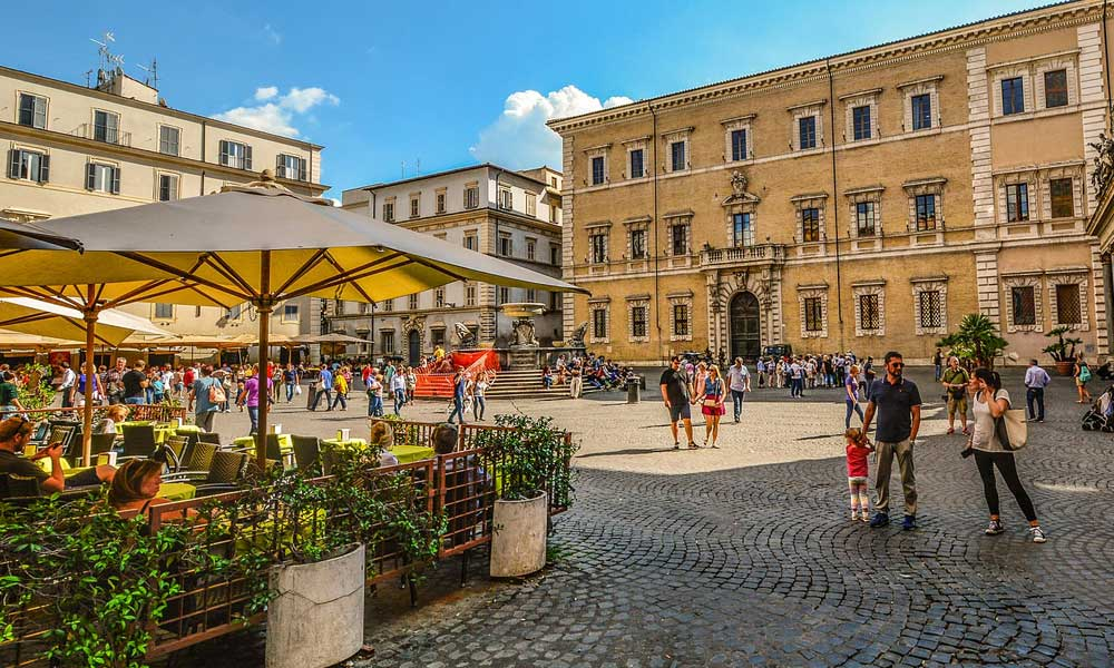 Shows a vibrant square in Trastevere, Rome - Top things to do in one day in Rome