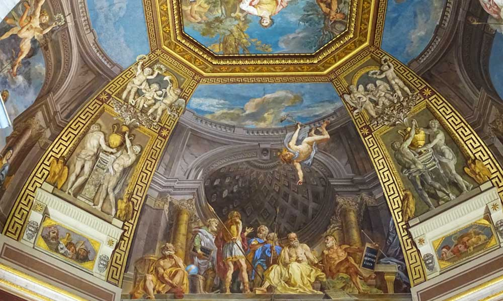 Shows a ceiling painting in the Vatican City Museums