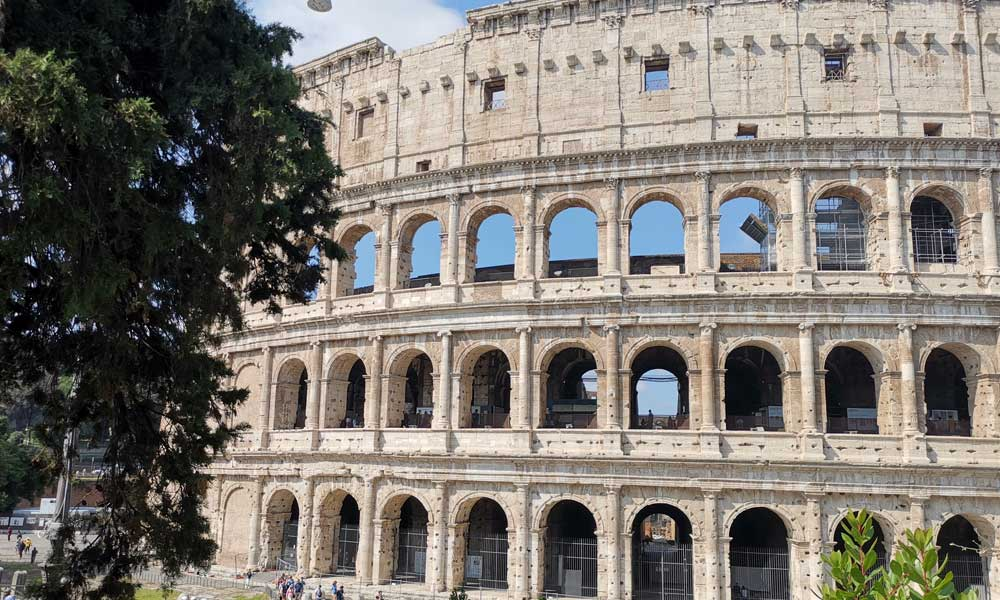 Tips for visiting Rome colosseum - shows exterior of Colosseum arena