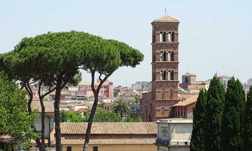 Shows view of Rome skyline from Palatine Hill - Rome travel tips