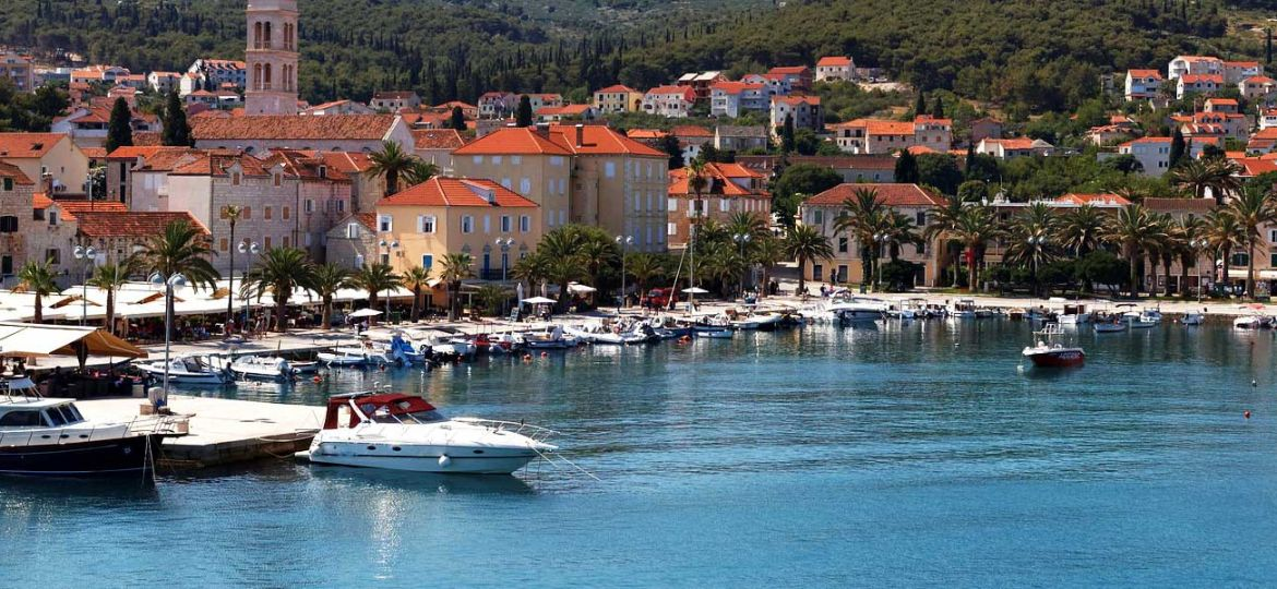 Where to go on holiday in July - Shows the marina of Hvar