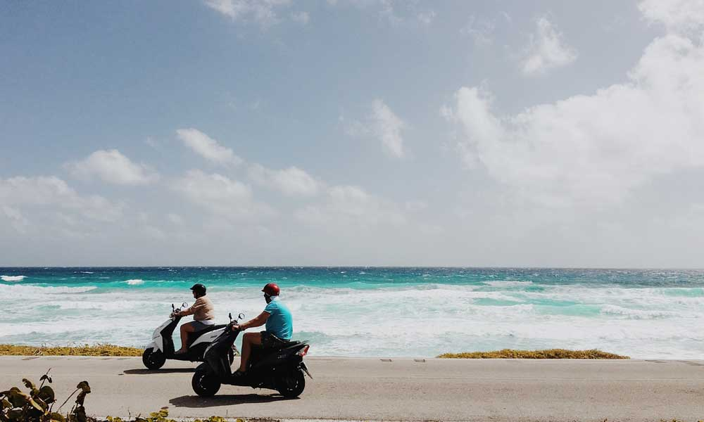 Novalja and Zrce Beach travel guide - shows two people on mopeds - getting around