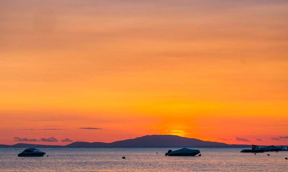 Zrce Beach and Novalja Nightlife - shows orange sunset
