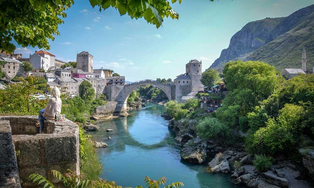 Renting a car in Croatia guide - Shows Mostar bridge in Bosnia