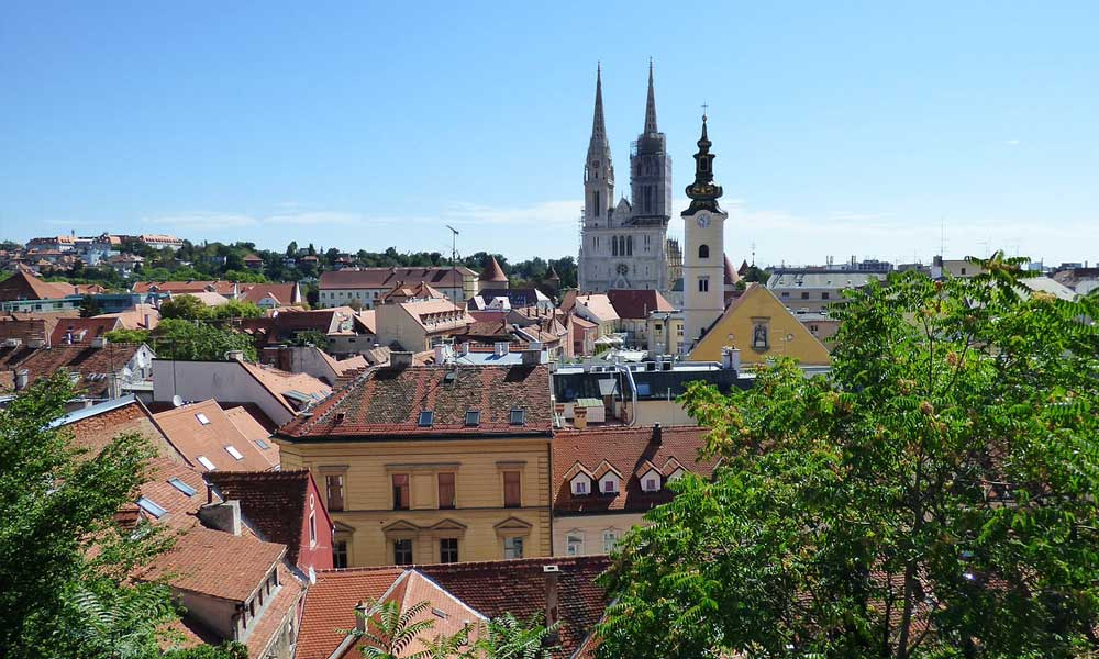 Best car hire Zagreb - Shows Zagreb city centre houses and church
