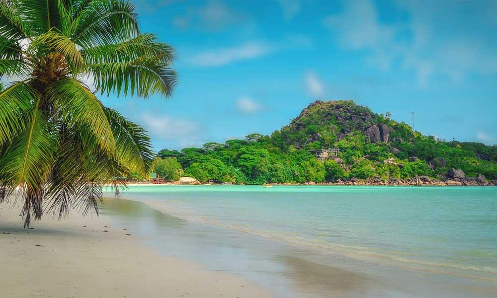 Shows a Seychelles tropical beach - September beach holiday ideas