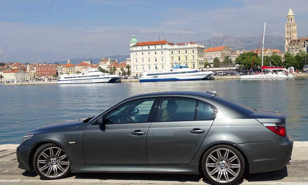 Shows a car alongside the marina - Split car rental