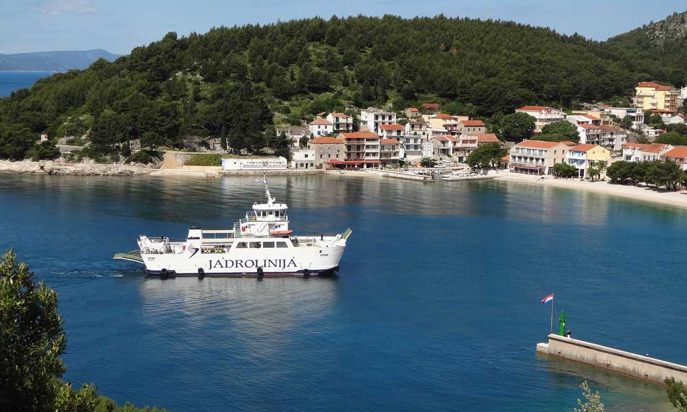 Shows Jadrolinija ferry at a port - Split travel guide to getting around