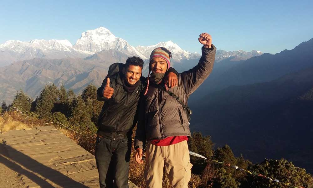 The best Nepal treks - Shows two trekkers in front of a mountain range