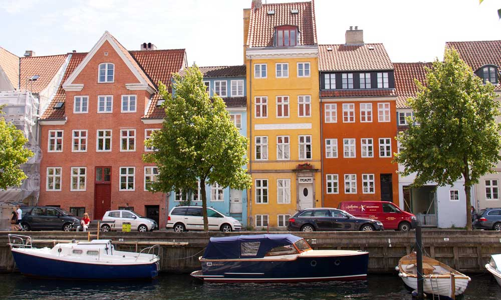 Shows colourful houses by Copenhagen marina - October half term city breaks