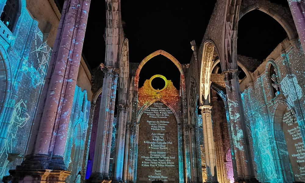 Places to visit in Lisbon - Shows the Under the Stars light-show at Carmo Ruins