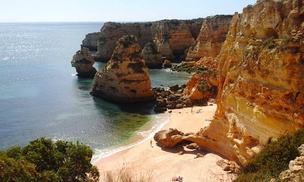 Shows a scenic cove and beach in Lagos - Portugal 2 week itinerary