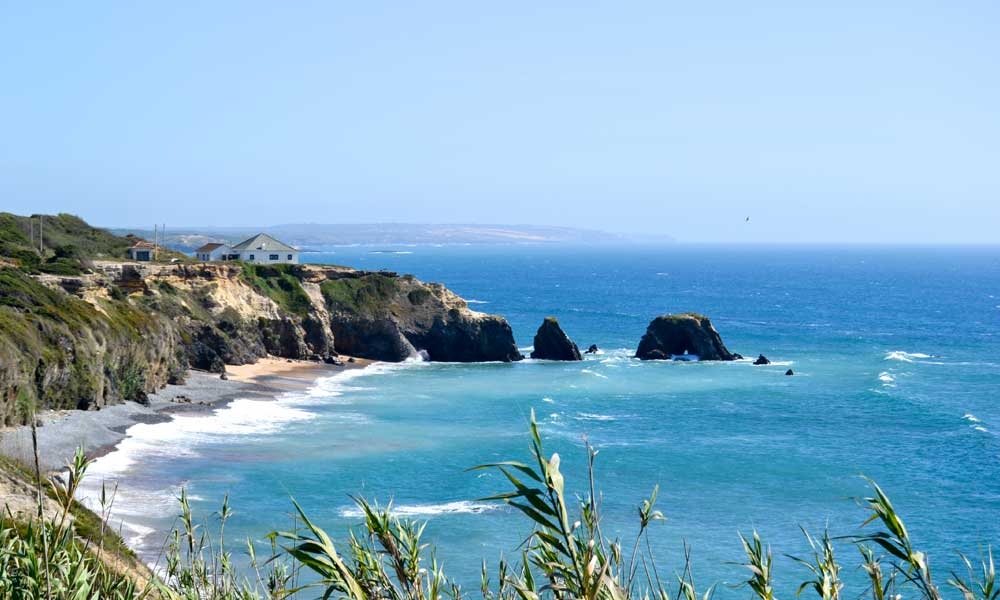 Shows a scenic viewpoint of Sudoeste Nature Park in Portugal - Road Trip Ideas
