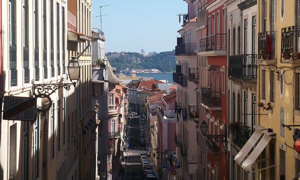 Shows the colourful streets of Lisbon - Best road trip itinerary for Portugal
