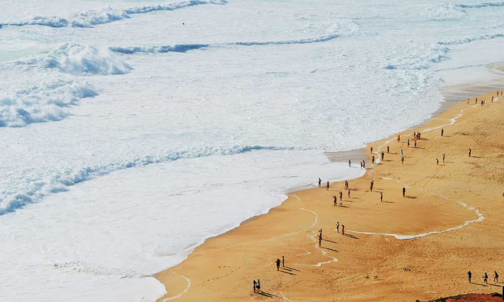 Portugal road trip itinerary - Shows Nazare surfing beach