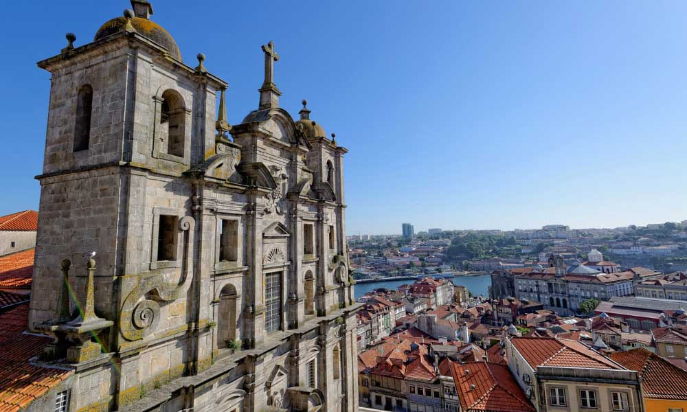 How to get from Porto to Faro - Shows a church and city streets in Porto