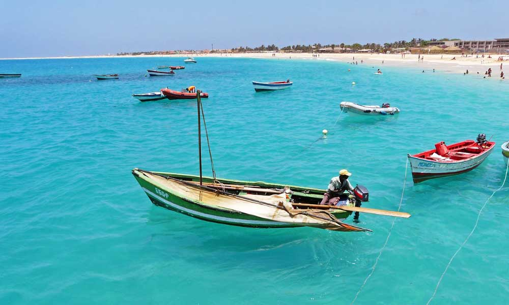 Shows small boats and a beach in Cape Verde