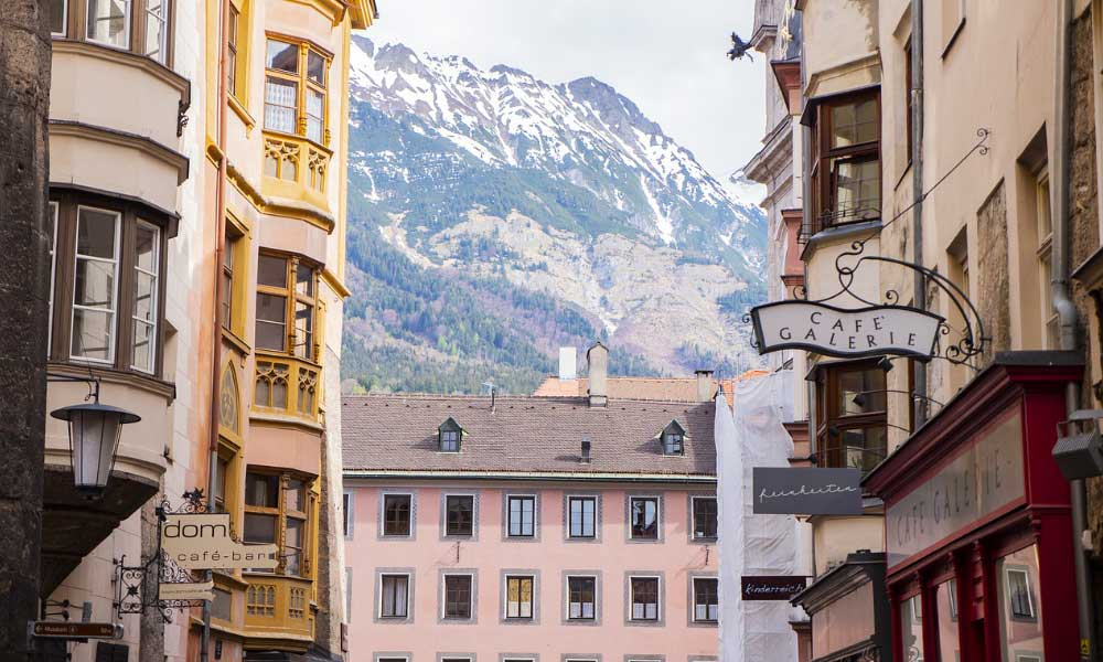 Shows the town of Innsbruck overlooking the mountains - November city break ideas