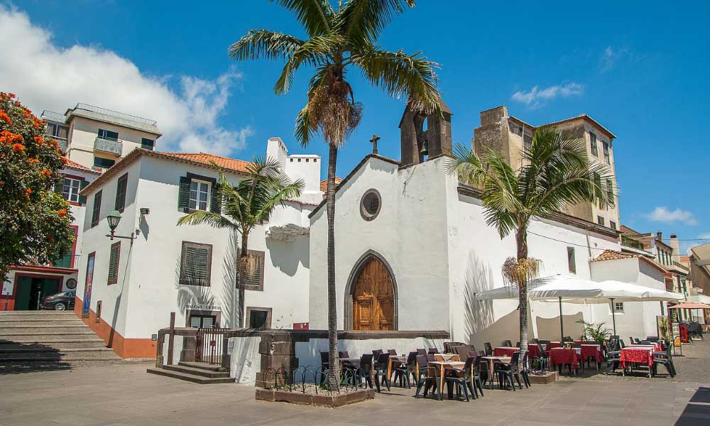 Where to go on holiday in November - Shows a traditional town in Madeira