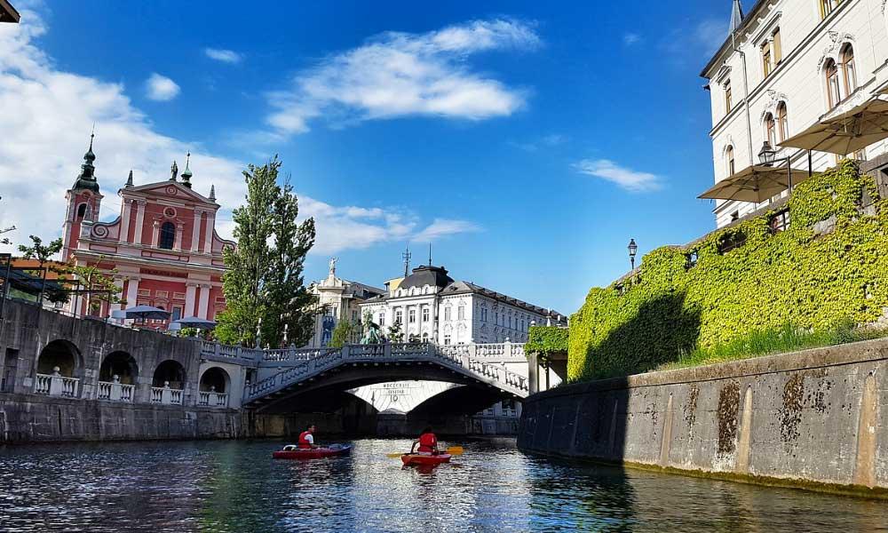 City breaks in November - shows the river and colourful buildings of Ljubljana