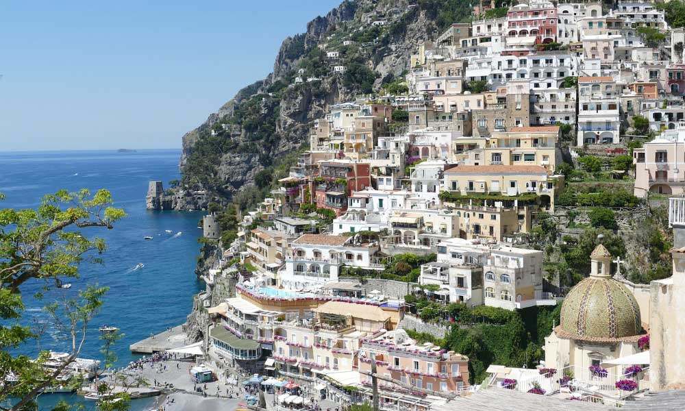 Shows the terraced buildings of Positano - 2020 holiday ideas