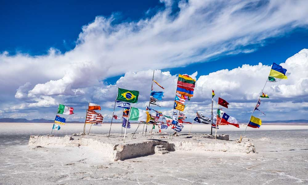 Adventure destinations for 2020 - Shows a collection of flags on the salt flats of Bolivia