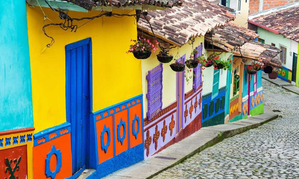 Shows the colourful buildings of Medellin in Colombia - Cheap places to go on holiday in South America