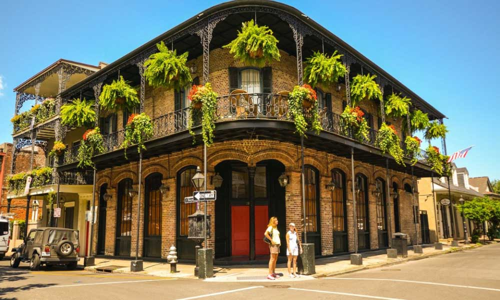 Shows a quaint corner building in New Orleans - Cheapest places to visit in the US