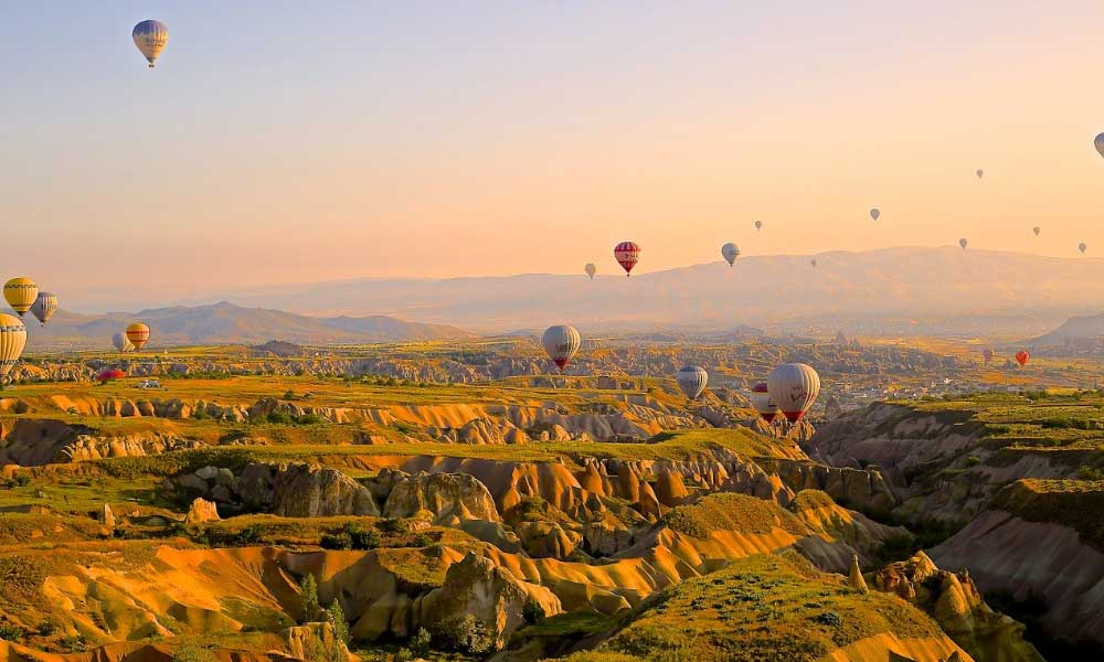 The cheapest places to go on holiday in the world - Shows a hot air balloon show in Turkey