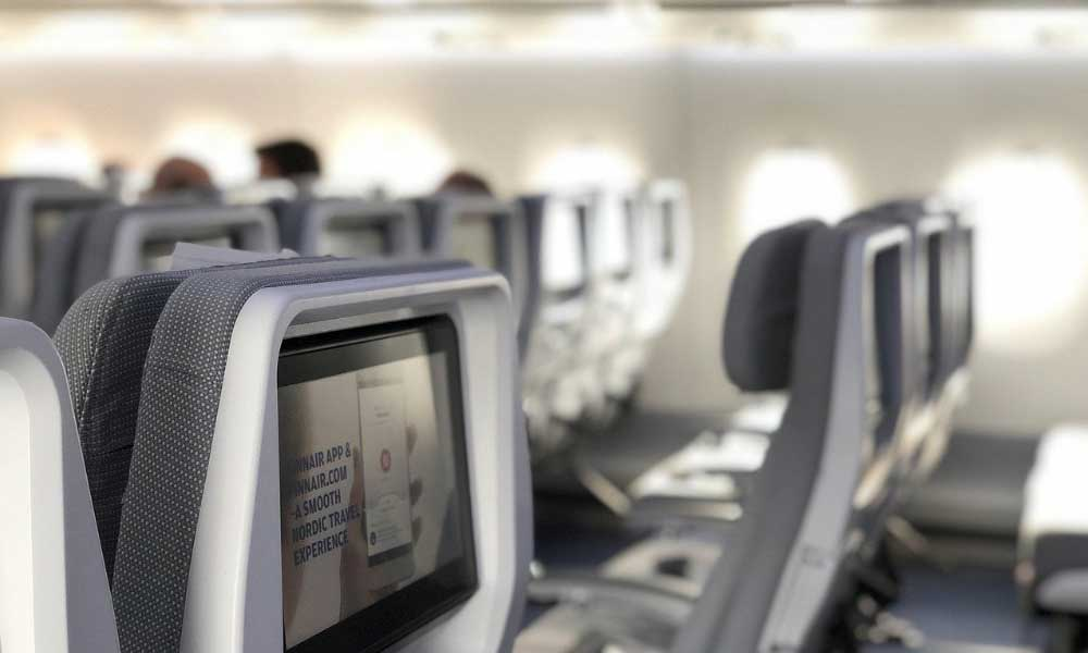 Things to do on a long haul flight - Show an aeroplane cabin with WiFi connections