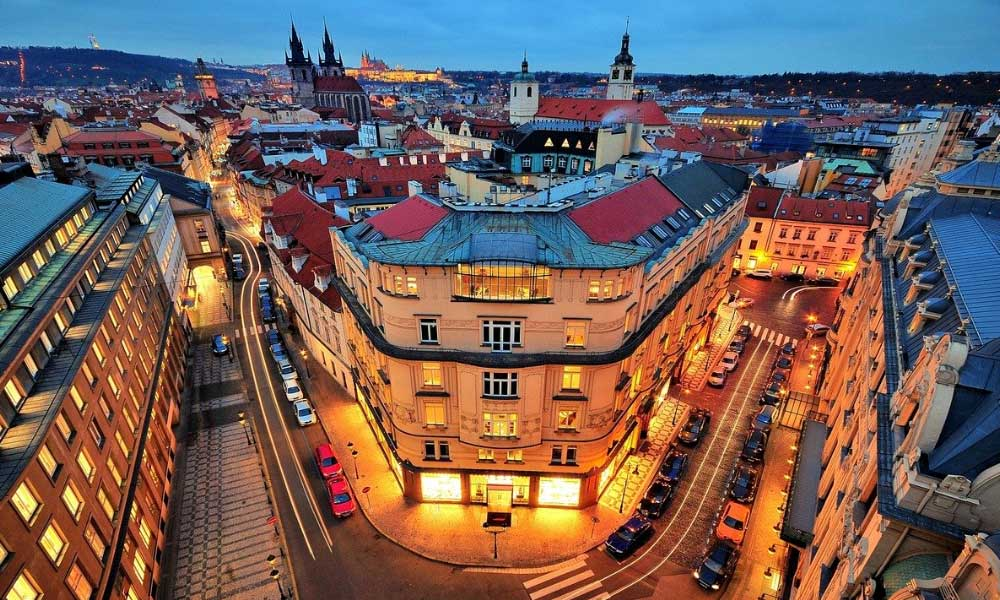 Shows the streets of Prague at night