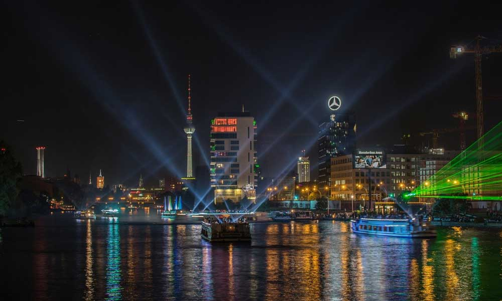 Shows Berlin light show on the river