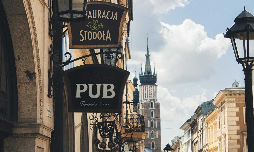 Shows a pub with Krakow castle in the distance - European stag do ideas