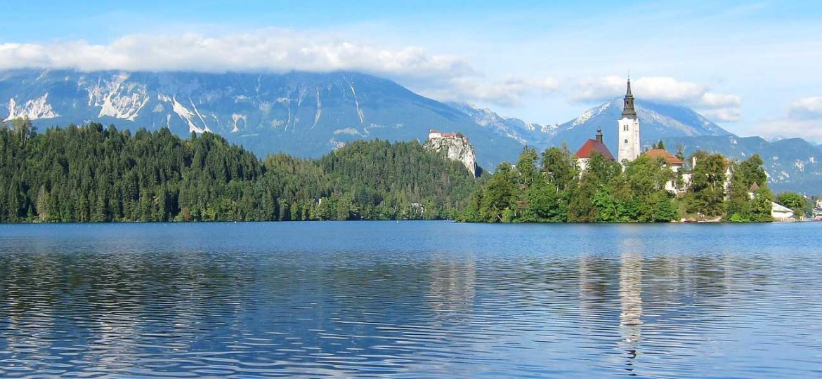 Cheap countries to go on holiday around the world - Shows Lake Bled in the summer