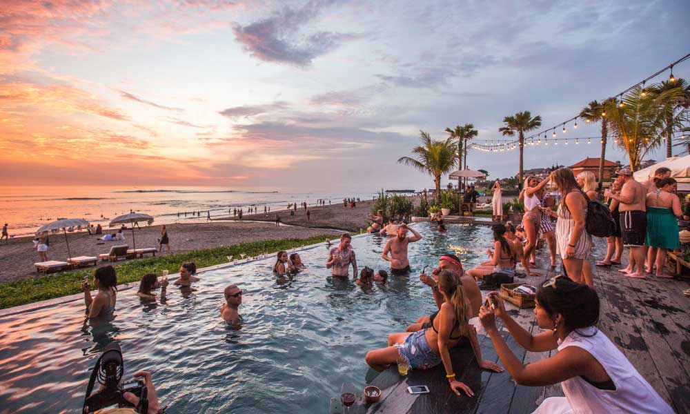 Shows Canggu beach and a swimming pool at sunset - 3 weeks in Bali