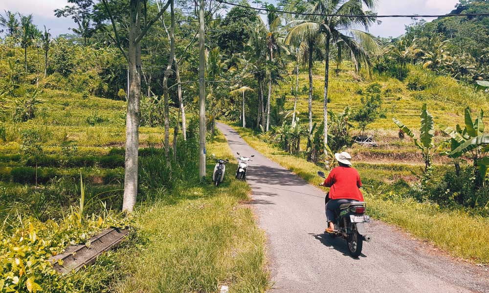 How to get around in Bali - Shows a local woman on a moped