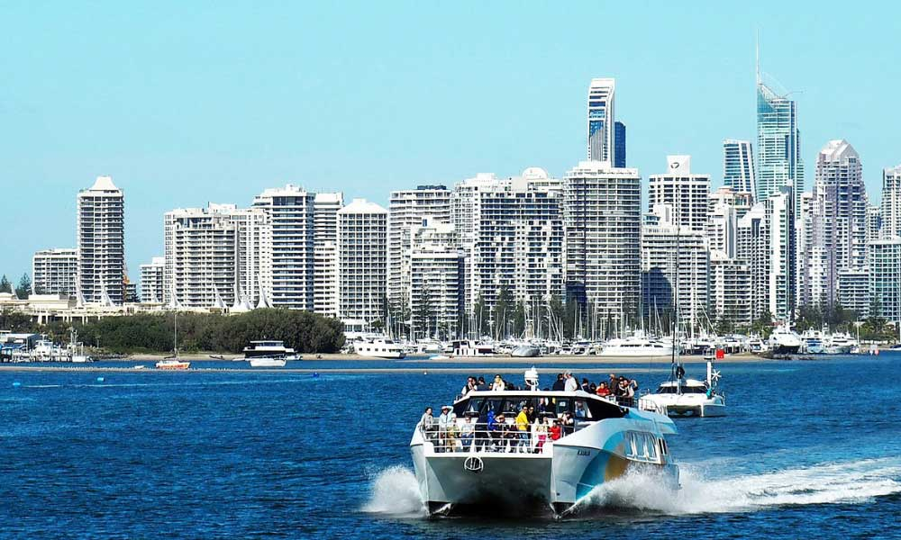 Solo holiday destinations - Shows a speed boat overlooking a city in Australia