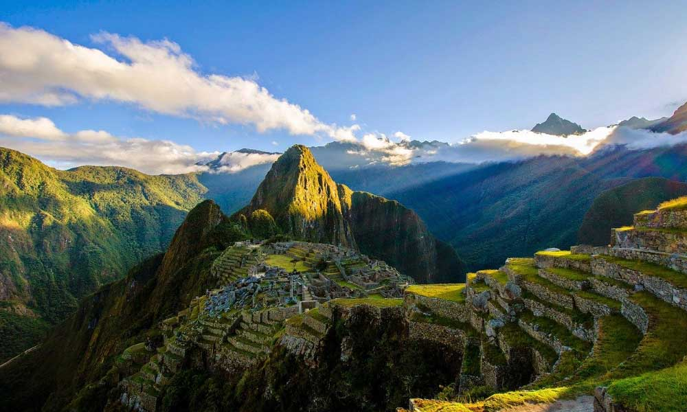 Solo adventure holiday destinations - Shows ruins on a mountainside in Peru