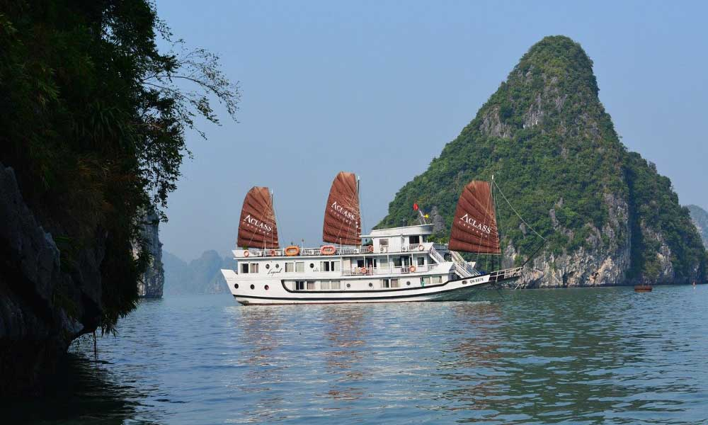 Shows a luxury cruise boat in Ha Long Bay, Vietnam