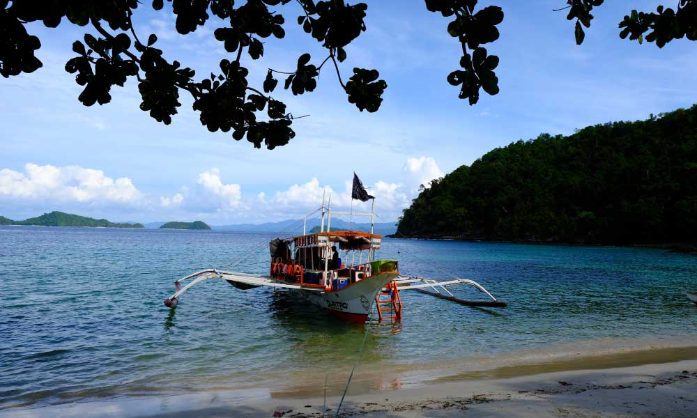 How to get to Palawan - Shows boat harboured on the beach