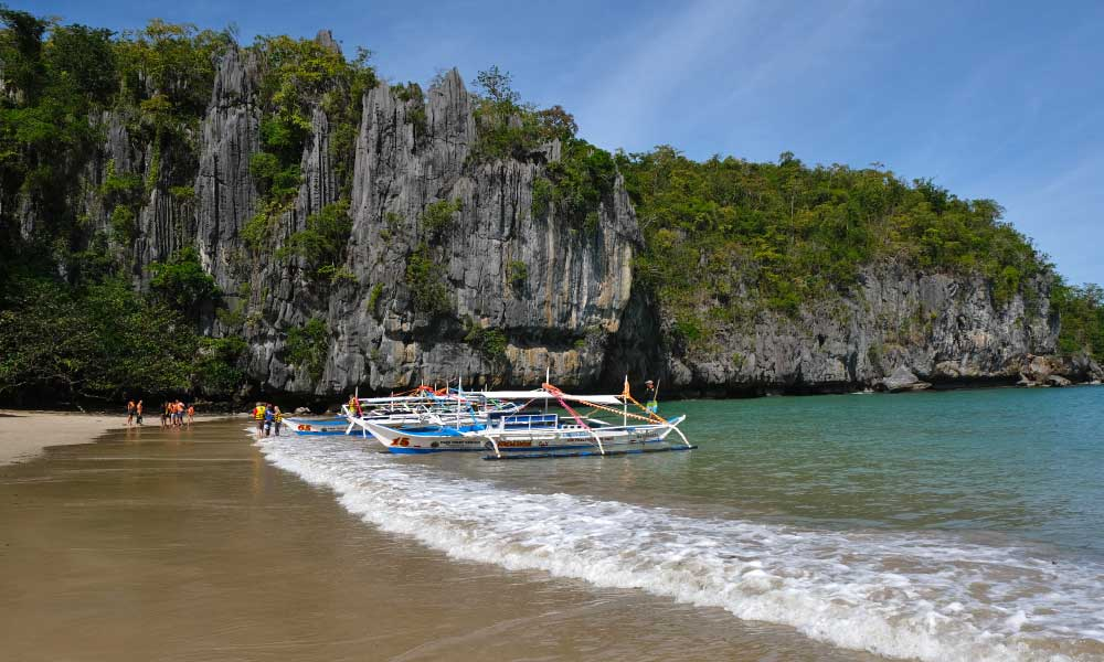 Shows a beach near Puerto Princesa Underground River - How to get to Puerto Princesa