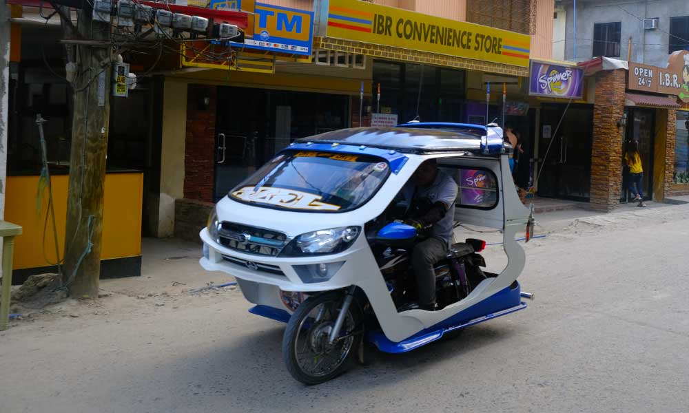 How to get to Palawan - Shows a Trike taxi in El Nido town